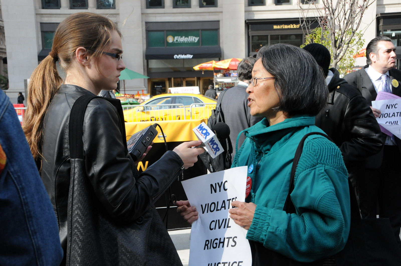 photo of WOR reporter interviewing a demonstrator